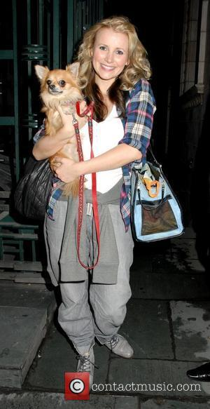 Carley Stenson holding her dog outside the Savoy Theatre after appearing in 'Legally Blonde: The Musical' London, England - 29.10.10