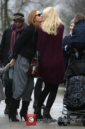 Stella McCartney kisses newly pregnant Claudia Schiffer whilst doing the school run London, England - 18.01.10