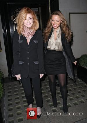 Nicola Roberts and Kimberley Walsh leaving Scotts restaurant. Kimberley got in her waiting cab while Nicola drove away in her...