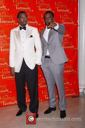 Sean Diddy Combs with his wax figure at the unveiling of the Sean Diddy Combs wax figure at Madame Tussauds...