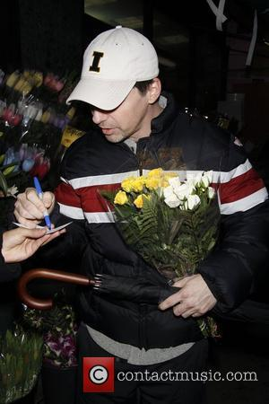 Sean Hayes  buying flowers on Eighth Avenue after rehearsing for his upcoming Broadway musical 'Promises, Promises'.  New York,...