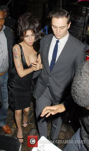 Amy Winehouse and Reg Traviss Shaka Zulu - launch party at the Stables Market - outside departures London, England -...