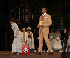 Jesse L. Martin Curtain call for the opening night of 'The Merchant of Venice' at Shakespeare in the Park, held...