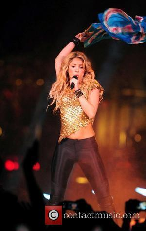Shakira Picks Up Stage Invader