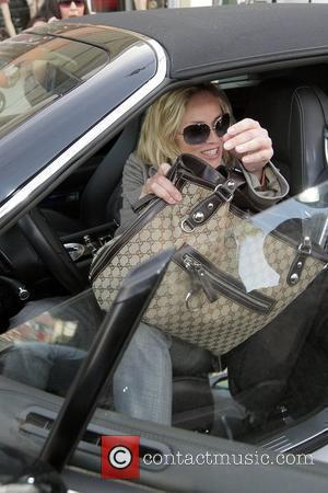 Sharon Stone leaving Elizabeth Skin Care in Studio City in a playful mood and makes funny faces at the photographers...