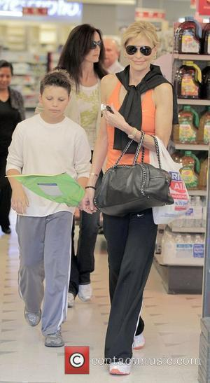 Shawn King the soon to be ex-wife of TV personality Larry King, with her son shopping at Rite Aid Pharmacy...