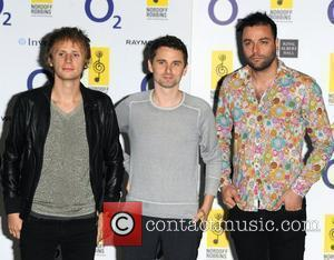 Dominic Howard, Matt Bellamy and Christopher Wolstenholme of Muse O2 Silver Clef Awards 2010 held at the London Hilton, Park...