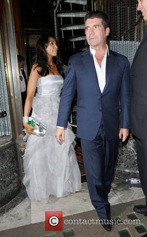 Simon Cowell and A Female Companion Leaving Mr Chows Restaurant
