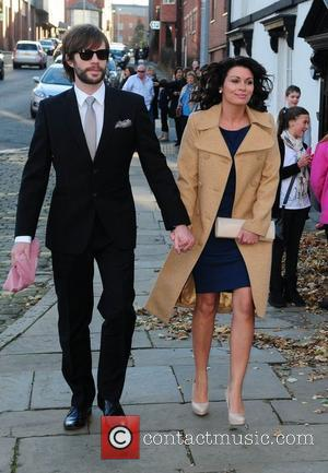 Adam Huckett and Alison King arrives for the wedding of Simon Gregson and Emma Gleave at St Bartholomew's Church...