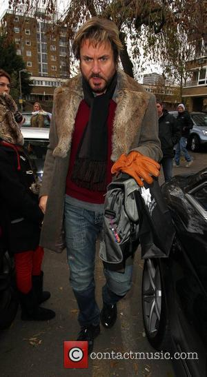 Simon Le Bon arrives at a West London studio in his vintage Mini London, England - 29.11.10