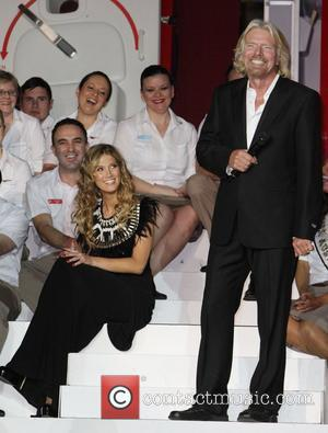 Delta Goodrem and Sir Richard Branson  Sir Richard Branson celebrates Virgin Australia Airlines tenth birthday with an invitation-only concert...