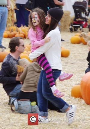 Soleil Moon Frye  takes her daughter to Mr. Bones Pumpkin Patch in West Hollywood Los Angeles, California, USA -...