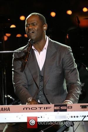 Brian McKnight  performs at the 'Songs For Hope' event, held at The Grove in Hollywood Los Angeles, USA -...