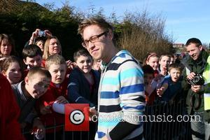 Russell Howard signs autographs at a Primary School while taking part in The BT Sport Relief Million Pound Bike Ride....
