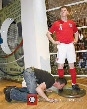 Football fans visiting Madame Tussauds have been willing England to turn around their poor performance by paying extra special attention...