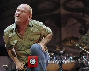 Corey Taylor  of 'Stone Sour' performing on stage during the 'Rockstar Energy Drink UPROAR Festival' held at the Molson...