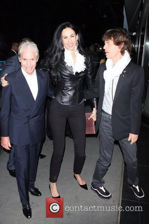 Mick Jagger, Charlie Watts, and guest Special screening of the Rolling Stones' 'Stones in Exile' at the Museum of Modern...