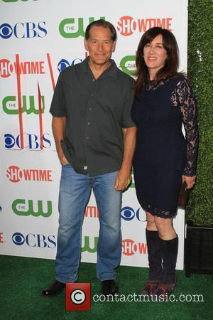James Remar and Guest 2010 CBS, CW, Showtime summer press tour party held at the Beverly Hilton Los Angeles, California...