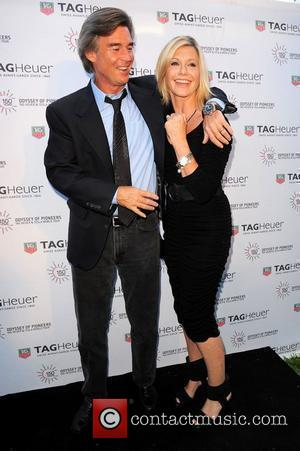 John Easterling and Olivia Newton-John TAG Heuer 150th Anniversary and 'Odyssey Of Pioneers' tour at the Temple House Miami, Florida...