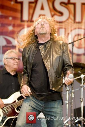 Robert Plant joins Los Lobos for an encore on stage at the 30th Annual Taste of Chicago 2010 at Petrillo...