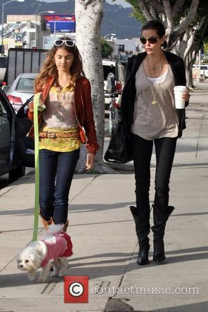 Teri Hatcher and daughter Emerson Rose hold hands after eating lunch at the Midi Cafe with their dog Los Angeles,...