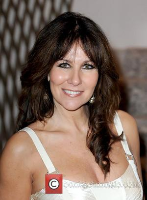 Linda Lusardi attends a tribute lunch for Sir Terry Wogan, held at the Dorchester Hotel London, England - 05.11.10