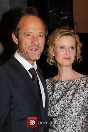 John Benjamin Hickey and Cynthia Nixon 'The Big C' cast attends a special screening held at the Paley Center for...