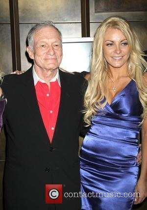 Hugh Hefner and Crystal Harris Playboy Playmate Claire Sinclair guest stars at The Crazy Horse Paris at the MGM Grand...