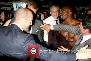 Jason Statham, Dolph Lundgren, Sylvester Stallone and Terry Crews, who is putting his shirt back on after taking it off...