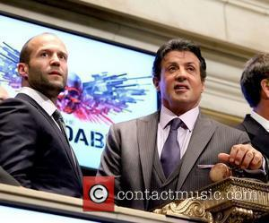Jason Statham and Sylvester Stallone The cast of 'The Expendables' visit the New York Stock Exchange to ring the Opening...