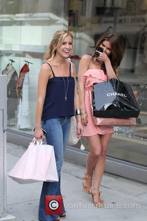 Kristin Cavallari and Audrina Patridge filming a scene for MTV's 'The Hills' leaving Madison Beverly Hills Boutique Los Angeles, California...