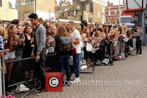 Siva Kaneswaran, Tom Parker, James McGuiness of The Wanted Boy band The Wanted outside MTV studios greeting fans London, England...
