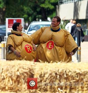 Hayley Tamaddon and Joe Swash in sumo suits outside the 'This Morning' studios London, England - 19.07.10