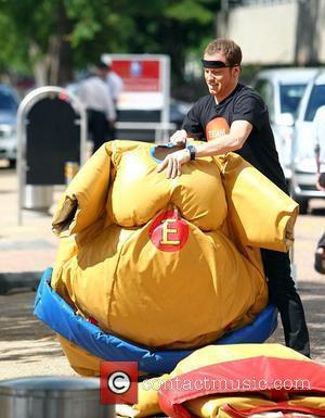 Joe Swash in a sumo suit outside the 'This Morning' studios London, England - 19.07.10