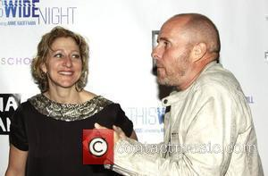 Edie Falco and Paul Schulze