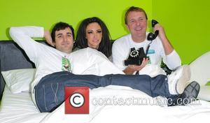 Phil Tufnell, Jodie Marsh, Patrick Monahan pose in a giant bed before attempting to complete a record-breaking 24-hour three-way call...