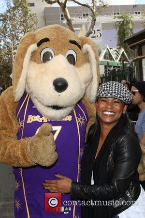 Nia Long Anne and Kirk Douglas Center host a Thanksgiving Meal for the Homeless held at the Los Angeles Mission....