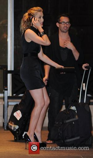 Leslie Bibb standing outside a Toronto hotel dressed in short black dress and platform heels. The 35th Toronto International Film...