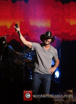 Tim McGraw  performing live on stage at Cruzan Amphitheatre. West Palm Beach, Florida - 08.05.10