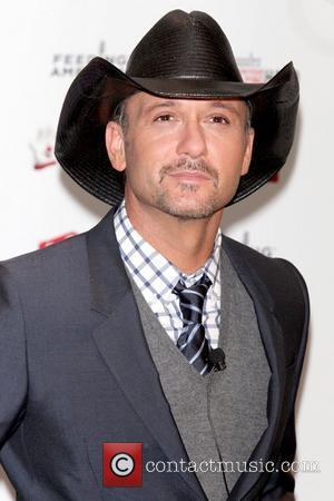 Tim McGraw attends a press conference to announce Hamburger Helper's 'Feeding America & Tim McGraw Partnership' to fight hunger at...
