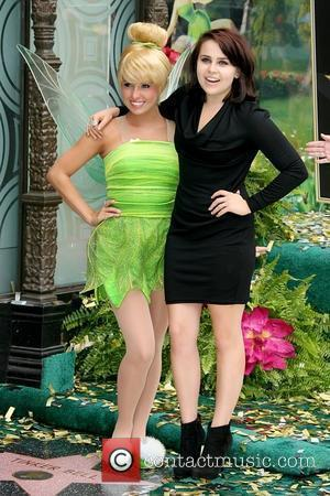 Tinker Bell and Mae Whitman Tinker Bell receives the 2,418th star on the Hollywood Walk of Fame Los Angeles, California...