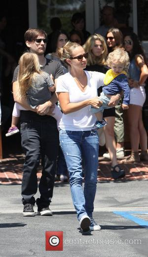 Tobey Maguire and his wife Jennifer Meyer (R) with their daughter Ruby Sweetheart and son Otis Tobias leaving Fred Segal...
