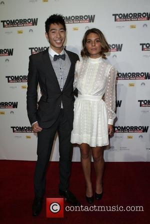 Caitlin Stasey and Chris Pang The premiere of 'Tomorrow When The War Began' held at Event Cinemas Sydney, Australia -...