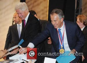 Bill Clinton and Tony Blair Former Prime Minister Tony Blair is awarded the 2010 Liberty Medal Ceremony at the National...