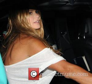 Elle MacPherson, who is blissfully unaware her dress has slipped down exposing her nipple, leaving Circus after attending Britain's Next...