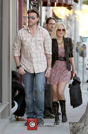 Dean McDermott and Tori Spelling filming for their reality show 'Tori & Dean: Home Sweet Hollywood' at ARCADE Boutique Los...