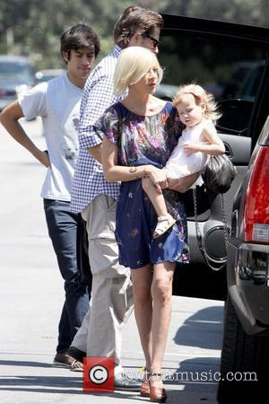 Dean McDermott, Tori Spelling and Stella McDermott  Tori Spelling goes to All Saints Episcopal Church with her husband and...