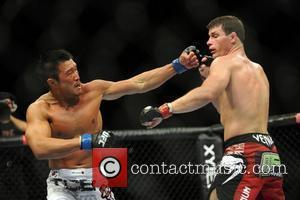 Michael Bisping in red of the UK and Yoshihiro Akiyama of Japan UFC 120 - Ultimate Fighting Championships held at...