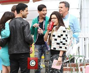 Adam Rodriguez, Mark Indelicato, America Ferrera and Tony Plana on location filming for 'Ugly Betty' in Queens New York City,...