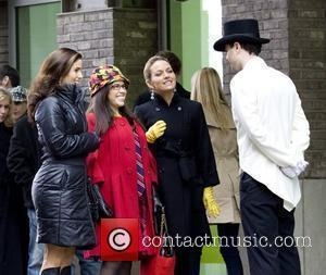 Ana Ortiz, America Ferrera and Becki Newton filming a scene for the TV show 'Ugly Betty' at the South Street...